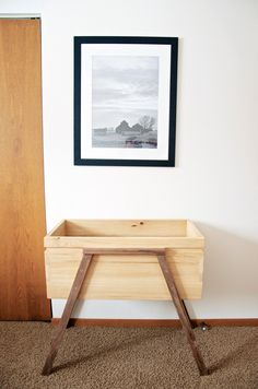 A beautiful mid-century modern inspired bassinet for your baby! Handcrafted Bassinet made with 100% American Harvested Ash & Walnut by turnerandbranch.
