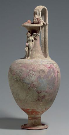 A CANOSAN POLYCHROME POTTERY OINOCHOE |  APULIA, CIRCA EARLY 3RD CENTURY B.C.