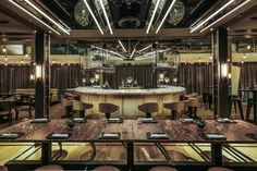 Hong Kong's Isono Eatery lets you dine in an open-plan industrial inspired landscape, whilst enjoying authentic, affordable Mediterranean-inspired dishes prepared by Michelin-star chef Paolo Casagrande. Timber walls are combined with rustic tables in a mix of both vintage and new furniture, championing craftsmanship and modern design.