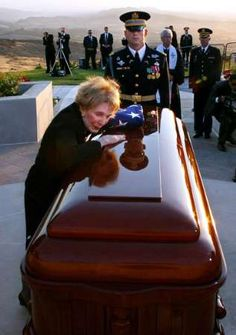 Former first lady Nancy Reagan grieves at the casket of her husband, President Ronald W. Reagan