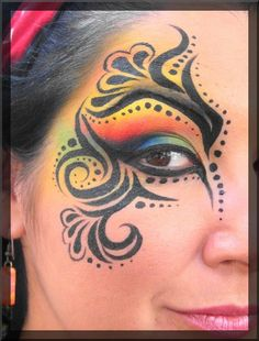Clean black filigree with an incredible saturation of color, perhaps not perfect for her eye shape but still amazing #festival #rainbow #makeup