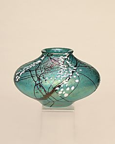 """Truly beautiful - """"Amazon Seed Pot"""" Art Glass Vase by Bryce Dimitruk - A majestic green, with silver black vines are surrounded by cascades of gem like green stone glass and bright white tube-like blossoms."""