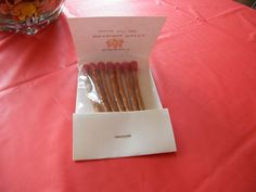 Party Favor -matchbook made out of card stock with pretzel sticks inside dipped in red chocolate to resemble matches