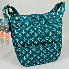 We love the print on this turquoise purse by Lug. The design boosts lots of pockets to allow you to have a place for everything you need to carry. Turquoise Purse, Sunflower Gifts, Holiday Wishes, Gift List, Gifts For Women, Diaper Bag, Pockets, Purses, Christmas