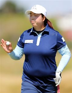 China's Shanshan Feng holds up her ball after a putt on the 9th green during the second day of the Women's British Open golf championship on the Royal Birkdale Golf Club, Southport, England, Friday July 11, 2014. (AP Photo/Scott Heppell) ▼11Jul2014AP|Wie misses the cut at Royal Birkdale http://bigstory.ap.org/article/wie-misses-cut-royal-birkdale #Womens_British_Open_2014 #Shanshan_Feng