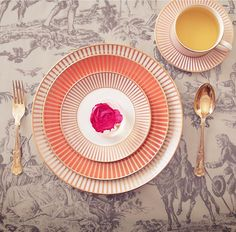 The Palladian collection from Wedgwood. #StylishDining - we love these coral stripes.