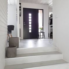 We love this entryway! The accent door is a nice contrast to the lighter colors. Light Colors, Entrance, Entryway, Villa, Bathtub, Doors, Bathroom, House, Inspiration