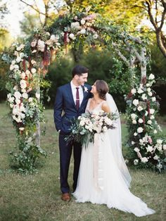 Floral Design: Three Branches Floral Design - http://www.stylemepretty.com/portfolio/three-branches-floral-design Wedding Dress: BHLDN - http://bhdln.com Groom's Attire: Calvin Klein - http://www.stylemepretty.com/portfolio/calvin-klein-5   Read More on SMP: http://www.stylemepretty.com/2017/03/03/burgundy-navy-texas-fall-wedding/