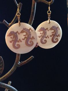 Dragons on shells by HandScreativedesigns on Etsy, $20.00