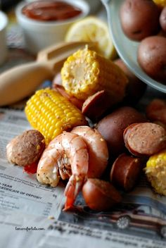 Spicy Shrimp Boil - Shrimp, spices, potatoes, sausage and corn!  Finger food at it's best! www.lemonsforlulu.com