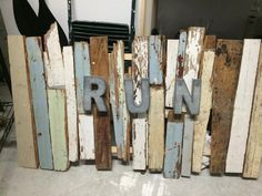 Wall hanging created from salvaged boards from the original Orlando Police Department's mounted police stables, circa 1840s.  Metal RUN letters.