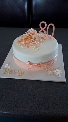80th birthday cake in shades of apricot. Cake by Homemade By Hollie.