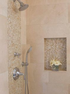 Mosaic tile backsplashes are gorgeous accents against neutral stone to create a luxurious feel in this contemporary shower.