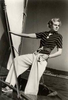 Girl wearing nautical motif beachwear in a fashion photograph for the Nordiska Kompaniet department store in Stockholm, Sweden, ca. Vintage Outfits, Vintage Pants, Vintage Fur, Vintage Mode, Vintage Glamour, Vintage Ladies, Vintage Purses, Retro Vintage, 1930s Fashion