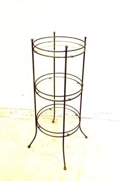 Vintage 1960s mid century brass/glass circular 3-tier table/stand; excellent condition.  Measurements 30.5 tall 12 diameter