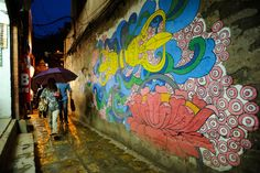 Colorful murals help to illuminate Nepal's dark side
