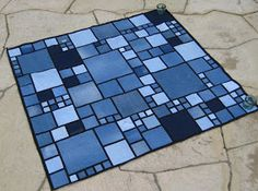 Don't you love this pattern? I have been looking for a denim quilt pattern to make use of a full tote of jeans parts that I've had for year...