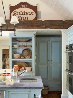 This functional and friendly kitchen gets a country vibe from the glazed blue cabinetry that dominates the color palette. The French blue paint unifies the unfitted pieces with built-ins and is subtly complemented by gray soapstone counters. Creamy white walls and rough hand-hewn beams add warmth to the palette. Your color personality: Serene and unruffled