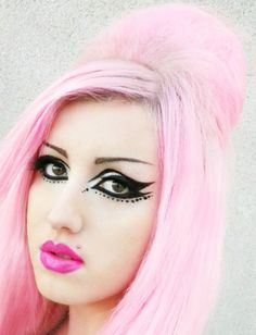 light pastel pink half bouffant hair paired with killer eyeliner.