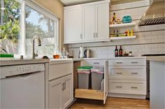 This classic setup with the dishwasher on one side of the sink and a pullout trash and recycling cabinet on the other side makes kitchen cleanup easier. It does require a pretty long bank of cabinets to make it fit, as you need 24 inches for a standard-size dishwasher,and at least 12 inches for the trash pullout.