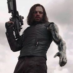 Caption: sebastian stan as bucky barnes, aka winter soldier. Mary Poppins, Slimming World, Grease, Mind Stone, Adoption, Channel, The Face, Scott Lang, Super Soldier