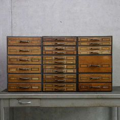 Wooden storage drawers in metal cases | From a unique collection of antique and modern industrial furniture at http://www.1stdibs.com/furniture/more-furniture-collectibles/industrial-furniture/