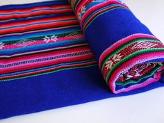 We love the colors in this textile from Peru. Would make a beautiful skirt or purse!