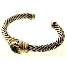 David Yurman Sterling Silver With 14kt Gold Bracelet  http://www.propertyroom.com/listing.aspx?l=9414644