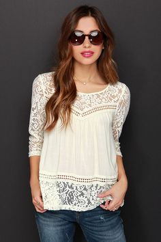 Combining all your favorite features, the Cute Rules Everything Around Me Cream Lace Top is worthy of praise! This lightweight woven top has a lace decolletage, topping off its relaxed fit bodice. Even more lace descends at back, creating a split back accent between the sheer fitted half sleeves. A final lace panel trims the waistline, waiting to be paired with your favorite high-waisted jeans. Unlined, and slightly sheer. 55% Cotton, 45% Polyester. Hand Wash Cold.