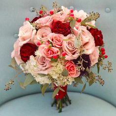 """""""I am loving this bridal bouquet!  Deep red roses accenting blush and dusty pink roses! This is a classic but beauty! #roses #bouquet #flowers…"""""""