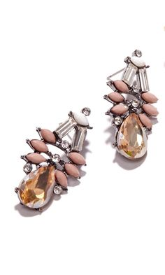 Statement earrings with clusters of glass stones and in 14k gold plated brass