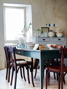 Love the blue table and rustic chairs.