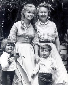 """Debbie Reynolds with her mother, Maxene, and her children, Carrie and Todd on the set of """"How the West Was Won"""""""