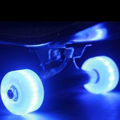 OMG! LED lights for your skateboard wheels!!! NO BATTERIES REQUIRED EITHER! :D   Blue - Flare Street Wheel Set