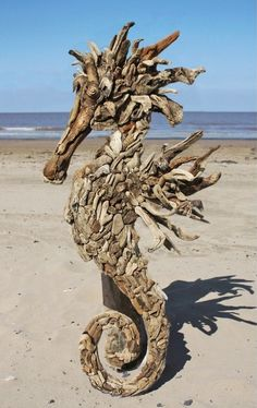 Artistic seahorse sculpture, created using driftwood is perfect decor for a spectacular Pool House. Driftwood Seahorse, Seahorse Art, Driftwood Sculpture, Driftwood Art, Sculpture Art, Sculptures, Seahorses, Ribbon Sculpture, Driftwood Furniture