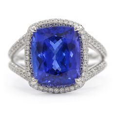 Tanzanite & Pave Diamond Ring: This beautiful gemstone ring features a 6.17-carat cushion cut Tanzanite found in only location in the world...Tanzania, Africa. Surrounding the Tanzanite is a total of .86-carat of round brilliant cut diamonds set in 18k white gold. Wixon Jewelers