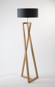 floor lamp Solid oak, brass Dim. 180 x 48 x 48 cm switch on the floor ©️️ photo : François Golfier #FloorLamp