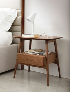 Night table with frame in solid canaletta walnut and one drawer. The drawer can be in the same finish of the frame or in a different colour.…