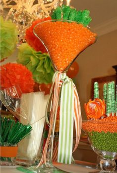 Carrot centerpiece:  trumpet-shaped vase, orange jelly beans and green rock candy sticks for the leaves.