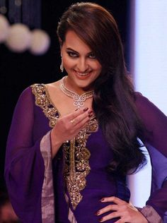 Brand Ambassador of D'Damas, Sonakshi Sinha who plays an aspiring actress in the upcoming film looked beautiful in a blue gown is all smiles on the ramp at India International Jewellery week 2013. #Bollywood #Fashion
