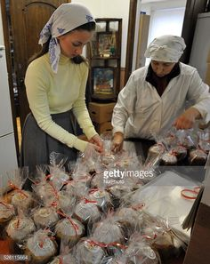 Workers of the church bakery prepare easter cupcakes in the... #kolpino: Workers of the church bakery prepare easter cupcakes in… #kolpino