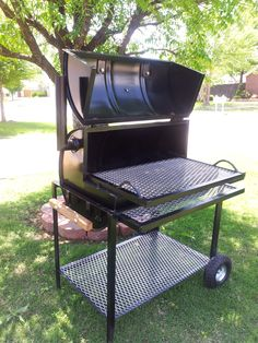 Hand made custom barrel bbq grill. Made to spec, give us a call if you want one!!!