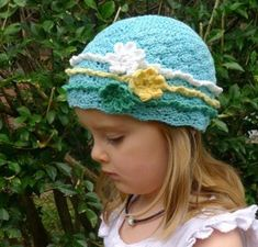 Don't look any further for an easy crochet pattern then this Gipsy Girl Beanie. Frills and flowers add the perfect embellishment to any crochet hat. Sizes are provided from newborns to adults.