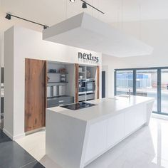 Next 125 kitchen with retractable doors and beautiful slanted Corian worktop. Showroom Design, Showroom Ideas, Interior Design, Next 125, Corian Top, Retractable Door, Work Tops, Doors, Beautiful