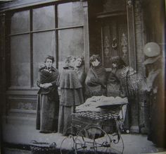 Shawled women waiting for the pawn shop to open in Dublin, Ireland.  (late 1800's or early 1900's)