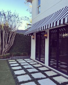 """""""Our sweet new client moved into the cutest house with the chicest black and white striped awnings--obsessed! #palomacontrerasdesign #designhouston…"""""""