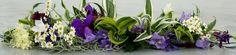 Posh in Dracaena en wild flowers in Purple