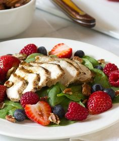 Mixed berries, chicken and pecans seasoned with cinnamon and ginger combine to make a delicious summer entree salad.