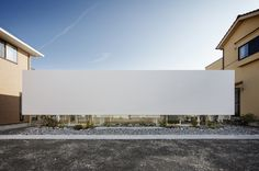 mA-style architects float a screen wall around a glass box. Very elegant and i wish i knew how they got planning permission because i can't imagine anyone in Montreal allowing us to do this and also how did they get the seamless finish in the metal screen- was it finished on site?