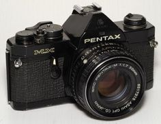 My very first SLR camera, a black body Pentax MX.
